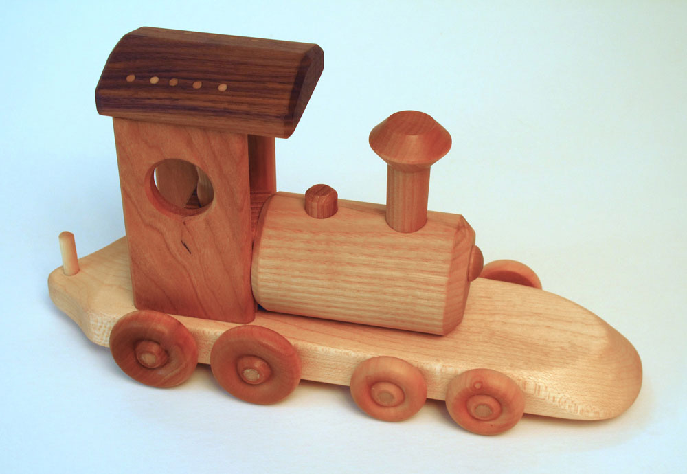 Wooden+Toy+Trains have made these hard wood trains and other wooden ...